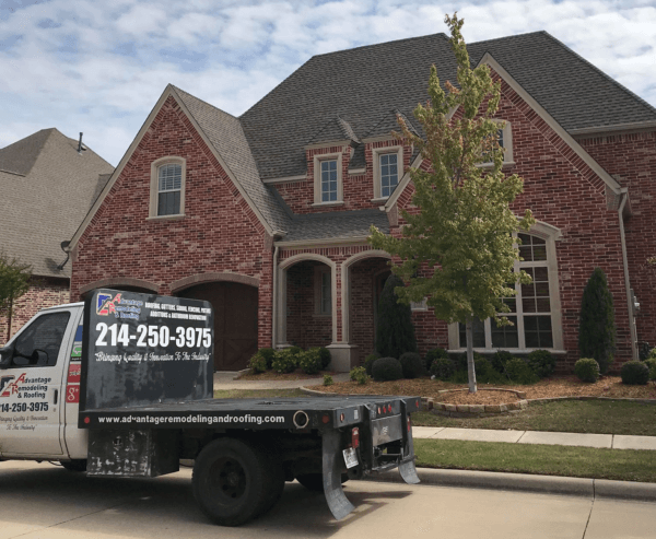 Advantage Remodeling and Roofing truck out front of clients house