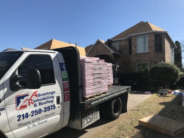 Advantage Remodeling and Roofing truck loaded with new materials