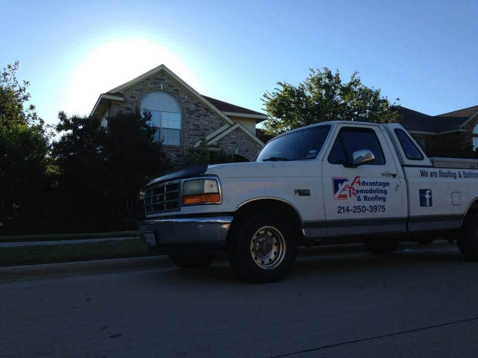 Advantage Remodeling and Roofing truck in front of customers home