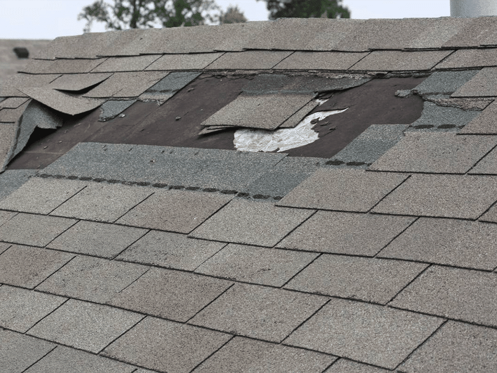 damaged shingle roof on house in Allen TX
