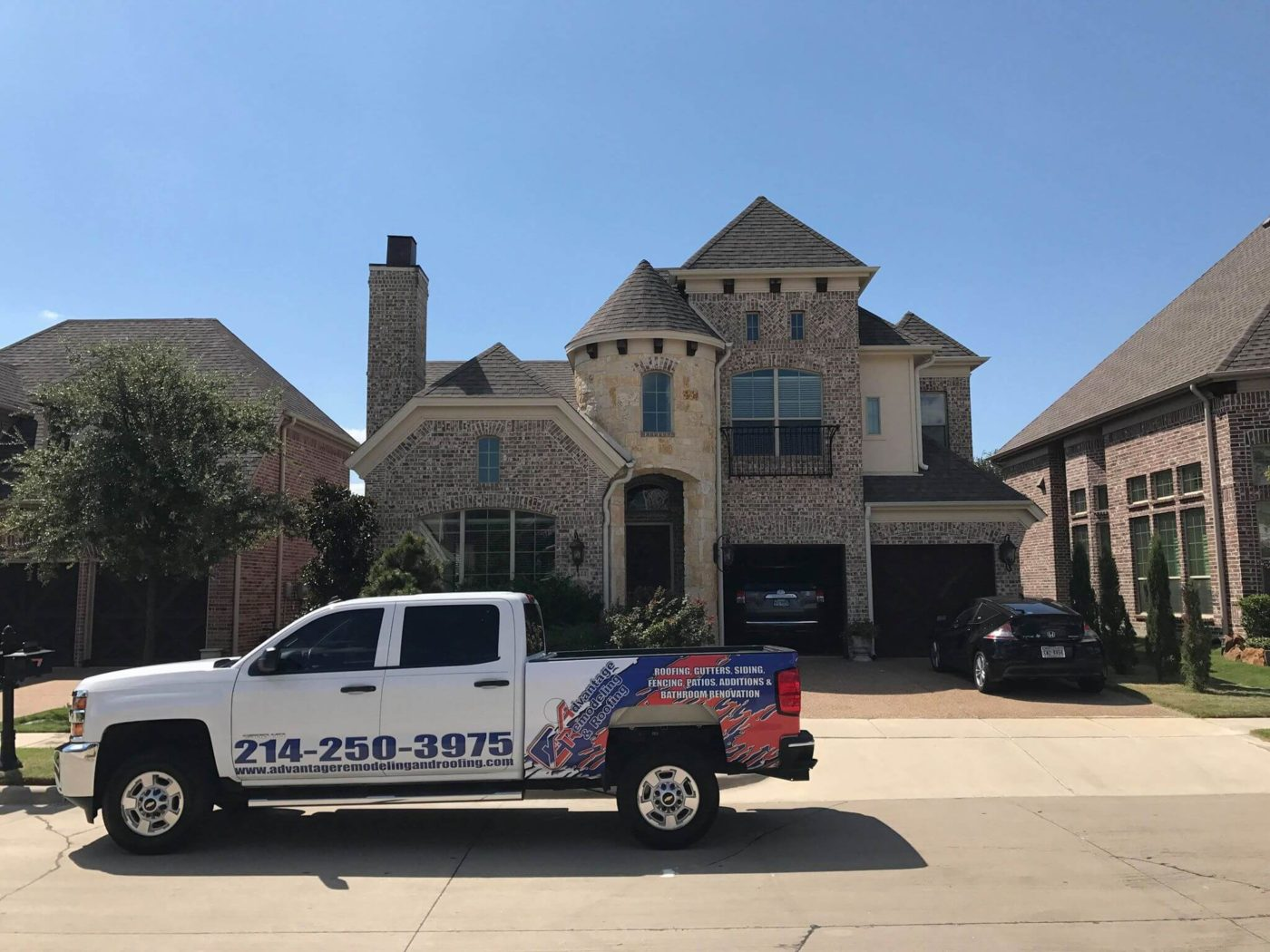 Advantage Remodeling and Roofing truck in front of clients