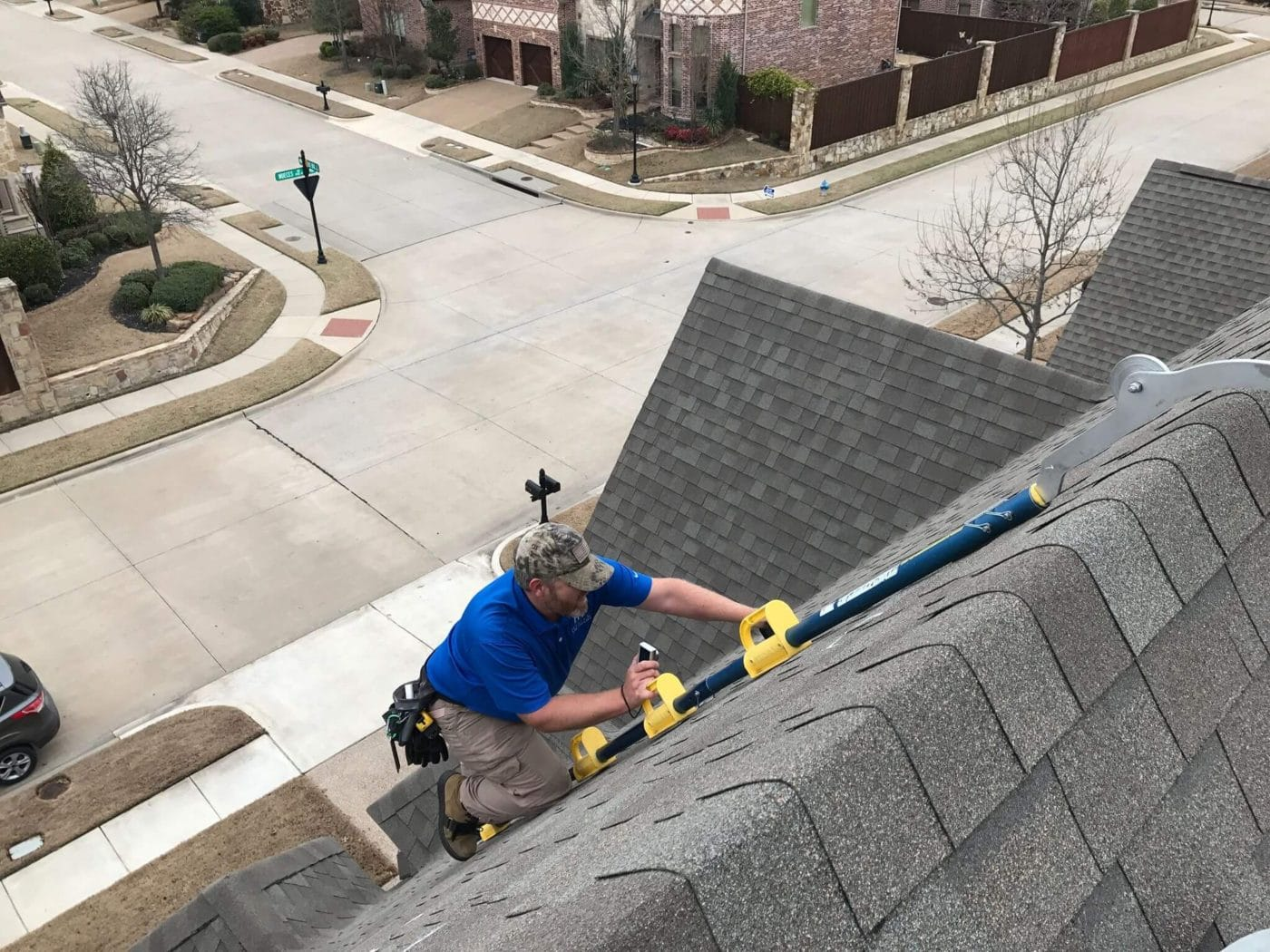 insurance claim adjuster inspecting roof