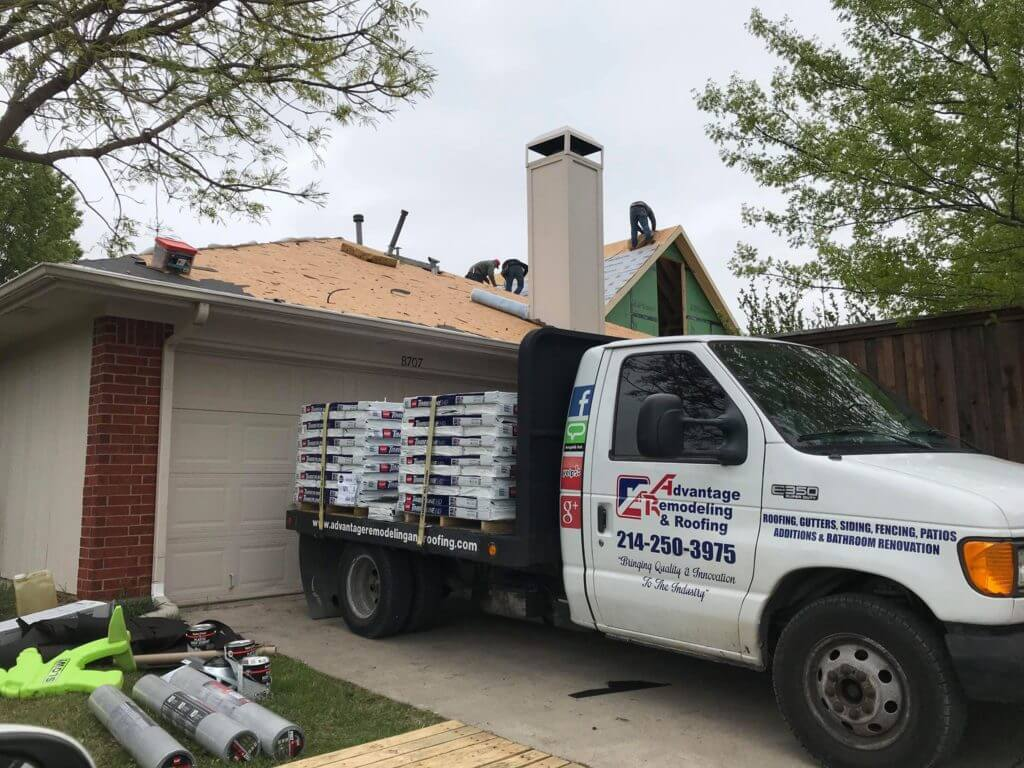 Advantage crew installing material on clients roof
